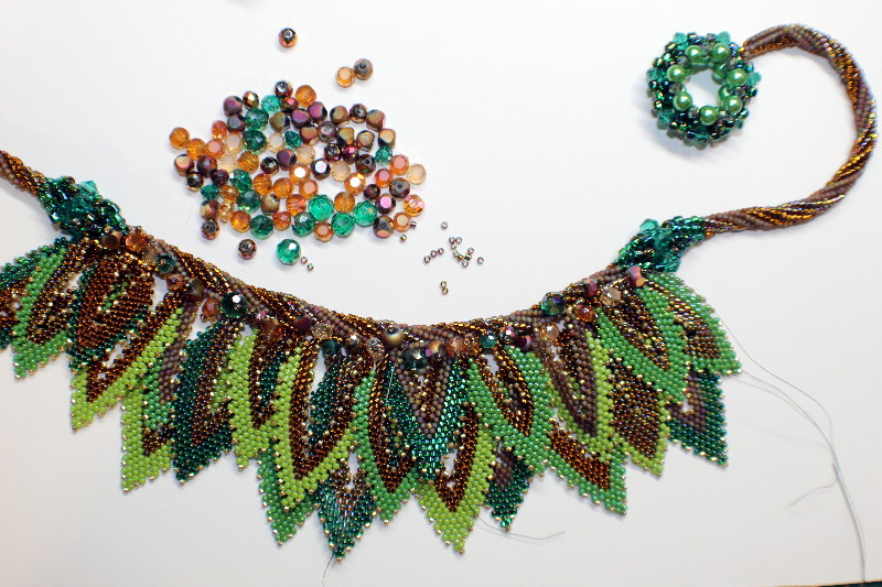 beaded necklace with a pile of beads