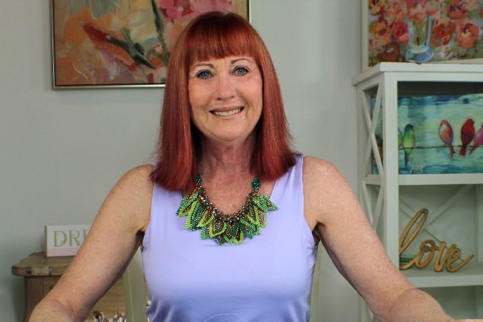 linda wearing the leaf necklace